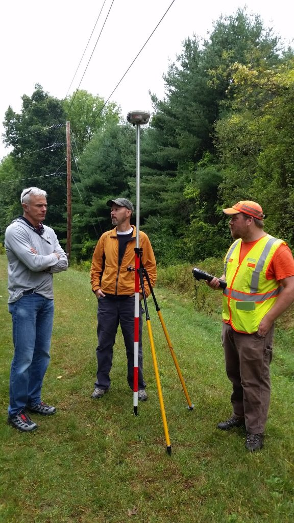 Instructor Paul Rydlund (left) oversees a stationing and elevation profile field exercise. Although incidental to the location, the overhead transmission lines allowed for testing of the impact on data quality.