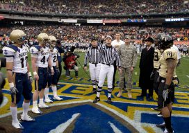 081220-N-7090S-110 Washington D.C. (Dec. 20, 2008) The referee conducts the ceremonial coin toss before the inaugural Eagle Bank Bowl between the Navy Midshipmen and the Wake Forest Demon Deacons. (U.S. Navy photo by Mass Communication Specialist 2nd Class Jhi L. Scott/Released)