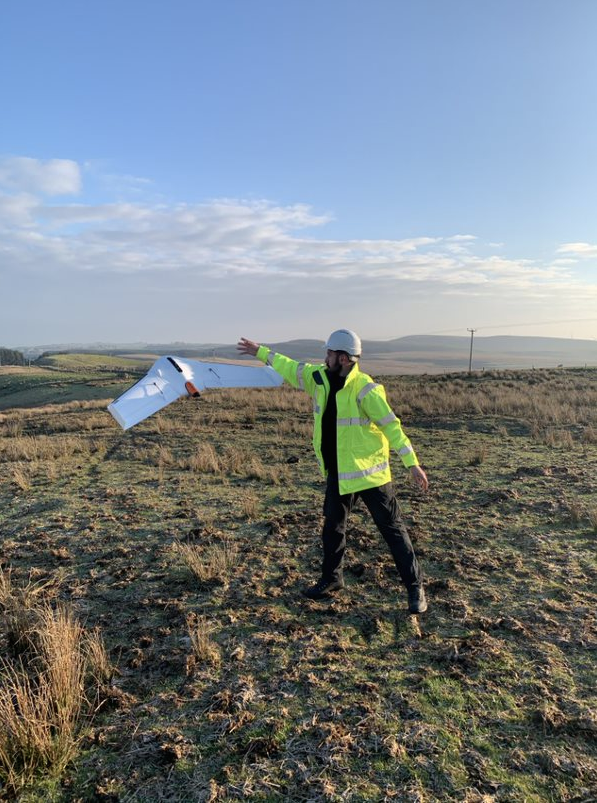 Derek Baxter, senior surveyor with Johnson, Poole and Bloomer, in Glasgow, Scotland, shows that launching Delair's UX11 mapping drone is almost as easy as throwing a Frisbee.