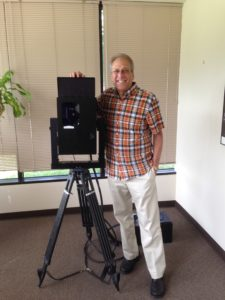 The author with original Cyrax 3D laser scanner. Note a large electronics box on the floor wired to the scanner. Not shown is a laptop that also needed to be connected to the scanner to operate it.