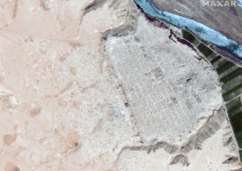 Satellite imagery of Dura Europos, Syria, an important archaeological site, shows the scale and extent of ISIS-led looting. The image (dark blue river) from April 2009 shows little impact compared to the image (light blue river) from April 2015 that shows pockmarked evidence of digging throughout the site.