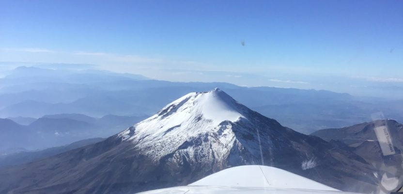 The Citation photogrammetry jet approaches Pico de Orizaba, the third highest peak in North America at 18,491 feet above sea level, on a photogrammetry mission.
