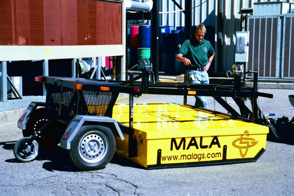 The author and the CART system in 2002, the first commercially available 3D GPR array system in the world.