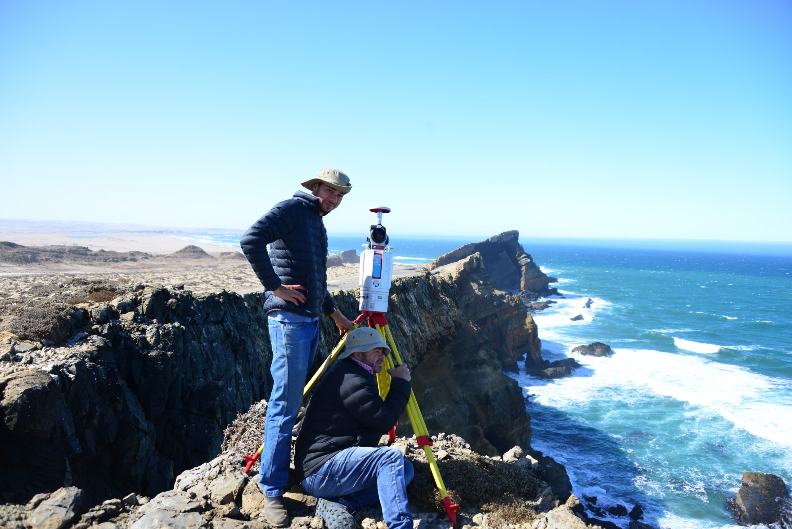 Herman Strydom and associate Guillaume van der Walt take a break and look out over the southern Atlantic Ocean with the RIEGL VZ-2000i on the remote Namibia coast. The remains are a part of Pomona, once a thriving diamond mining town in the African Sperrgebiet.